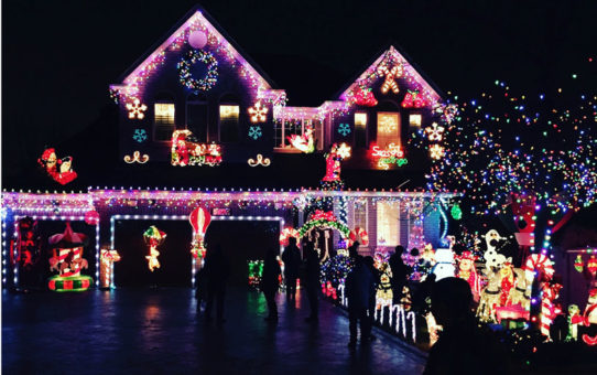 house decorated with christmas lights and decorations