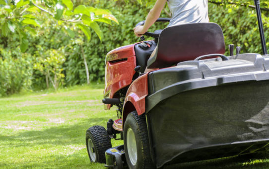 spring lawn care tips mowing yard on riding mower