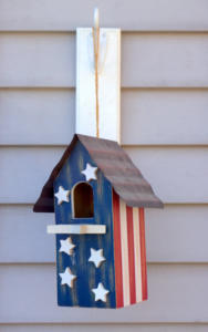 bird-house-hanging-on-vinyl-siding