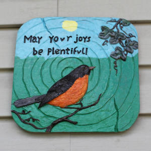 bird-plaque-on-vinyl-siding